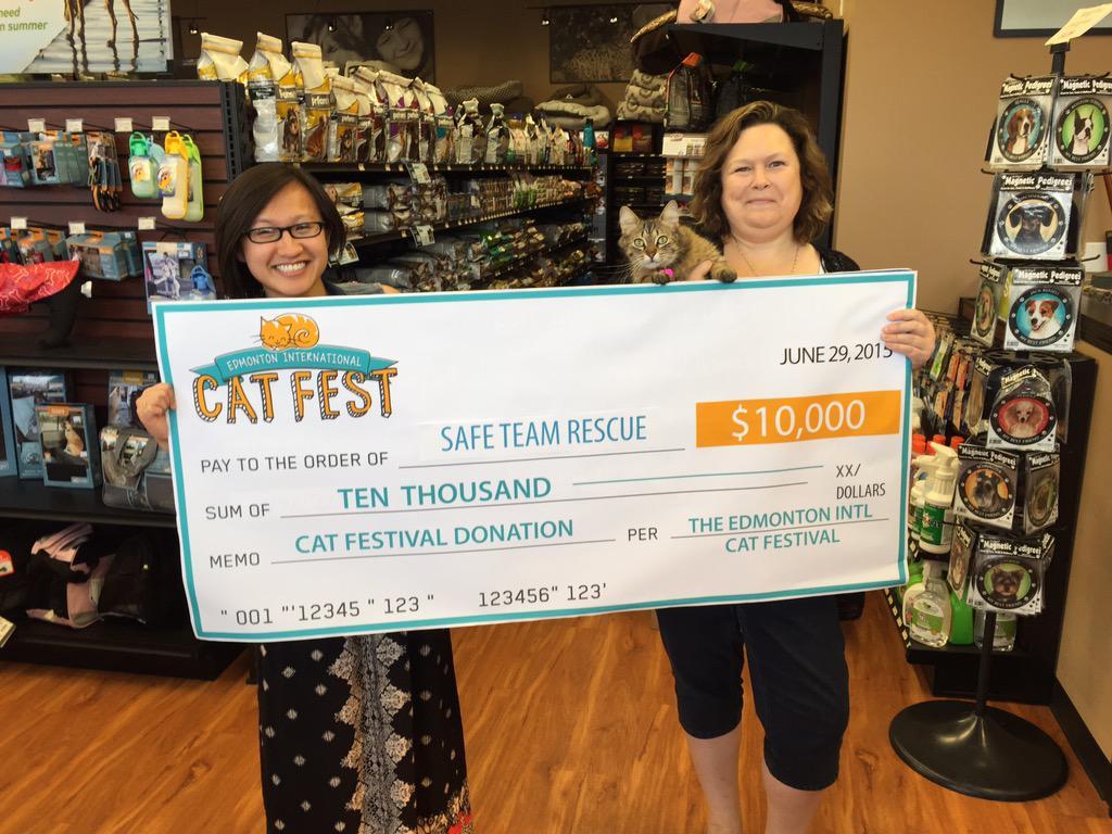 Edmonton International Cat Festival cheque presentation with SAFE Team Rescue.